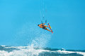 Recreational water sports action kiteboarding extreme sport su healthy man surfer kite surfing on waves in sea ocean summer fun Royalty Free Stock Image