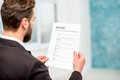 Recruiter with resume paper Royalty Free Stock Photo
