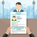 Recruiters hands holding cv and candidate
