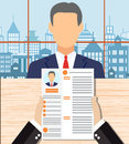 Recruiters hands holding cv in office