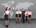 Recruitment agency business women with megaphone standing in front of other busines people Stock Photos