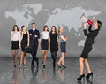 Recruitment agency business women with megaphone standing in front of other busines people Royalty Free Stock Image
