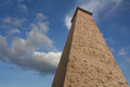 Rectangular brick chimney on a cloudy sky background. Stock Image
