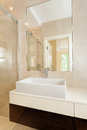 Rectangular vessel sink in modern bathroom white vertical Royalty Free Stock Photo