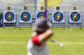 Recurve bow archery on target a person is shooting with a during an competition focus the targets Stock Image