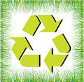 Recycle background with sign and green grass Royalty Free Stock Photo