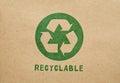 Recycle green symbol on cardboard Stock Photo