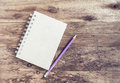 Recycle notebook and wooden pencil purple on wood background Royalty Free Stock Photo