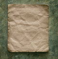 Recycle paper on cement wall Royalty Free Stock Photo