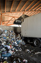 Recycle plant. truck unloading huge amounts of garbage, recycle Stock Image