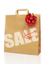 Recycle shopping brown bag with red ribbon Royalty Free Stock Photos