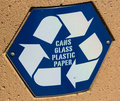 Recycle sign for cans plastic glass paper Stock Images
