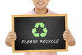 Recycle sign with please recycle texts on blackboard held by smiling man conservationist concept campaign Stock Photography