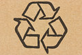 Recycle symbol on a cardboard Royalty Free Stock Photo