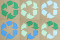 Recycle symbol on cardboard texture Stock Photos