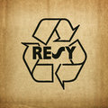 Recycle symbol on cardboard texture Royalty Free Stock Photo