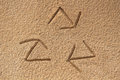 Recycle symbol written drawn in beach sand concept photo this shows a sign with three arrows created sea Royalty Free Stock Photography