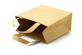 Recycled paper bag lying on white background Royalty Free Stock Images