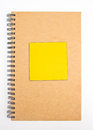 Recycled Paper Notebook Front Cover With Yellow Sticky Note. Royalty Free Stock Photo