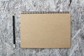 Recycled paper notebook on wood Royalty Free Stock Photo