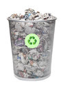 Recycling bin full of crumpled papers over white background Royalty Free Stock Images