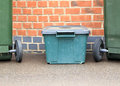 Recycling bins bin out for collection Stock Image