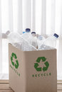 Recycling box filled with clear plastic containers Royalty Free Stock Photo