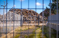 Recycling centre from behind a fence. Royalty Free Stock Photo