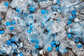 Recycling concept. problem of ecology, environmental pollution. Background of plastic bottles transparent blue net. Royalty Free Stock Photo