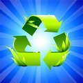 Recycling sign on glowing background Stock Photography