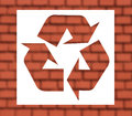 Recycling sign with red brickwall white Royalty Free Stock Photo
