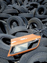 Recycling tires old used in a scrap yard waiting for Stock Photo
