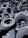 Recycling tires old used in a scrap yard waiting for Stock Photography