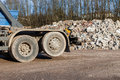 A recycling truck with rubble in the background Royalty Free Stock Photo