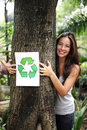 Recycling: woman in the forest with recycle sign Royalty Free Stock Photo