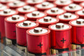 Red aa batteries many in a row Royalty Free Stock Photos