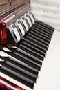 Red accordion and sheet music Stock Photos