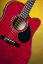 Red Acoustic Guitar on Yellow Stock Photo