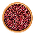 Red adzuki beans in wooden bowl over white Royalty Free Stock Photo
