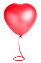 Red air balloon in a shape of a heart with ribbon Stock Images