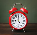 The red alarm clock showing 9-00 hours. Royalty Free Stock Photo
