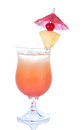 Red alcohol tequila sunrise or cosmopolitan cocktail decorated with pineapple and cherry isolated on a white background Royalty Free Stock Images