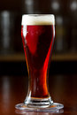 Red ale beer cold served in a cold glass on a dark bar Royalty Free Stock Image