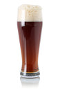 Red ale beer in glass with foam a isolated on a white background Royalty Free Stock Photography