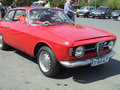 Red alfa romeo car at spring retro parade in bucharest romania Stock Photo