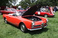 Red alfa romeo with an opened hood and no roof top Stock Photo