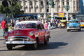 Red american car on paseo havana cuba february classic old in the streets of havana classic cars are still in use in cuba and old Stock Photos