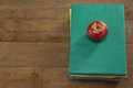 Red apple on book stack Royalty Free Stock Photo
