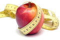 Red apple and centimeter Stock Photos