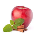 Red apple cinnamon sticks and mint leaves still life isolated on white cutout Stock Photo